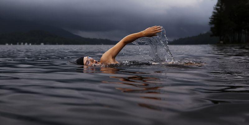 Photo of Woman Swimming in Lake