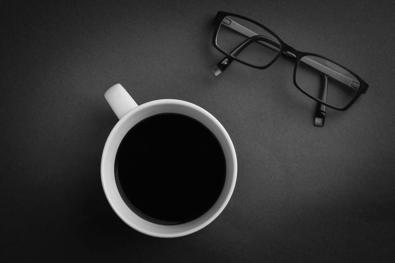 Photo of Coffee Mug and Eyeglasses