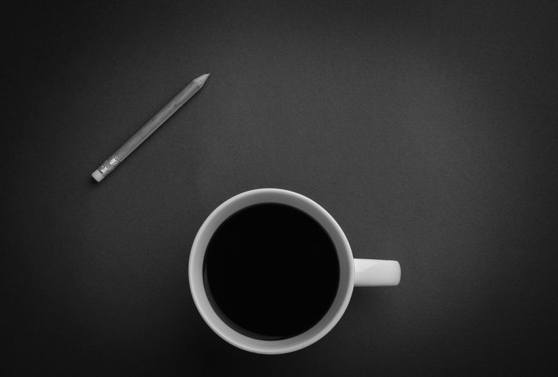 Photo of Coffee Mug and Pencil in Black and White