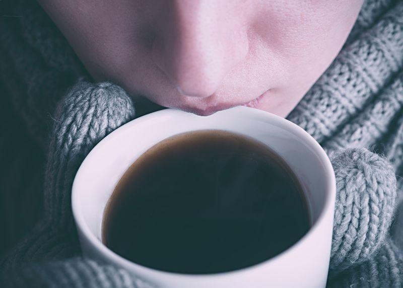 Photo of Woman Closeup in Sweater Drinking Coffee