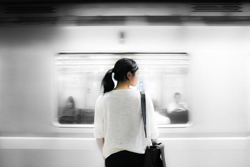 Photo of Woman Watching Subway Pass