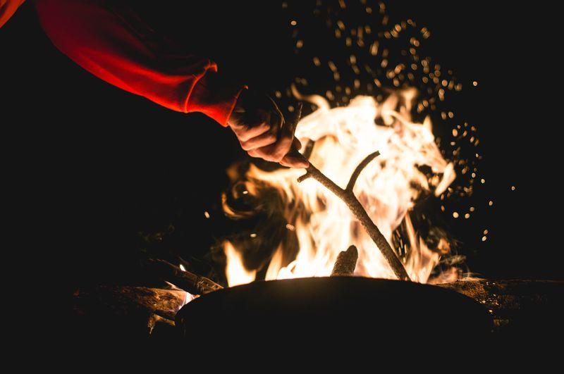 Photo of Person Building Bonfire