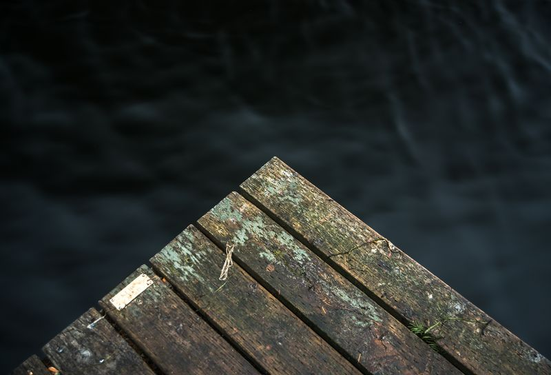 Photo of Edge of Wooden Dock over Water