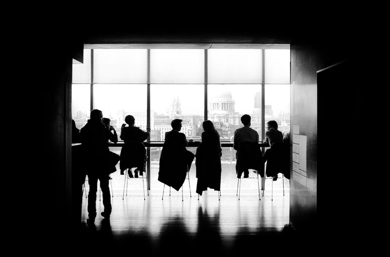 Photo of People at Tables Silhouette