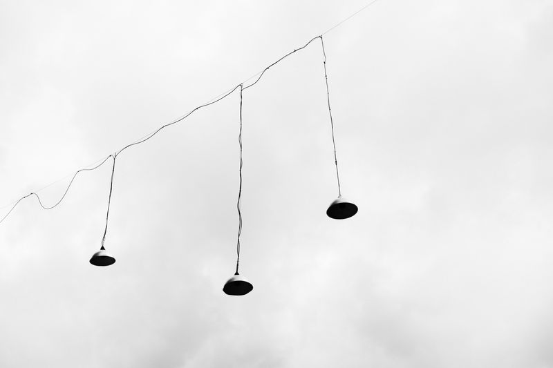 Photo of Lamps Hanging from Wire