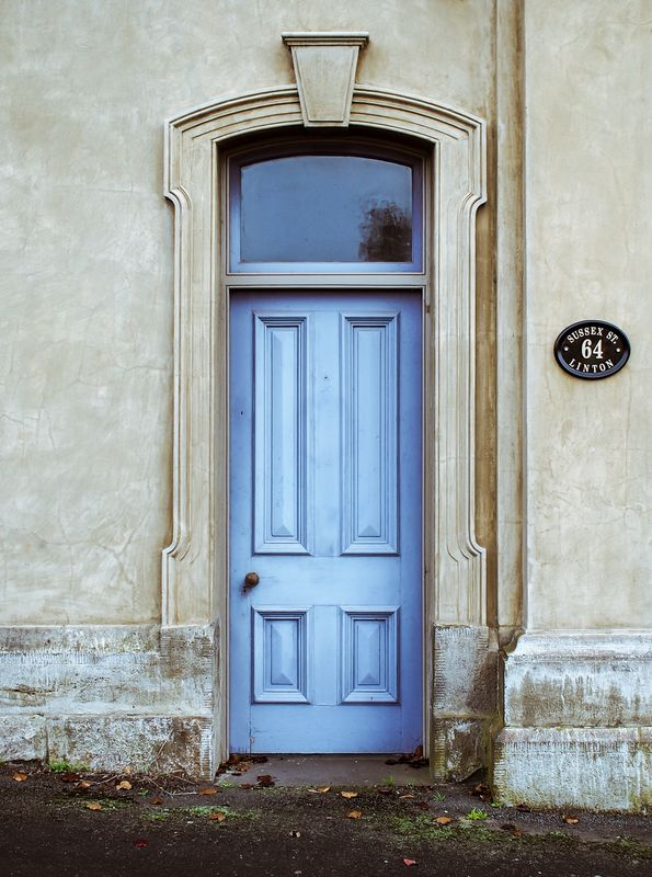 Photo of Blue Door on a Concrete Building