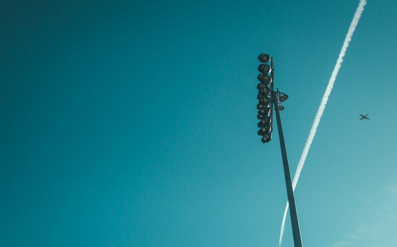 Photo of Airplane Flying over Stadium