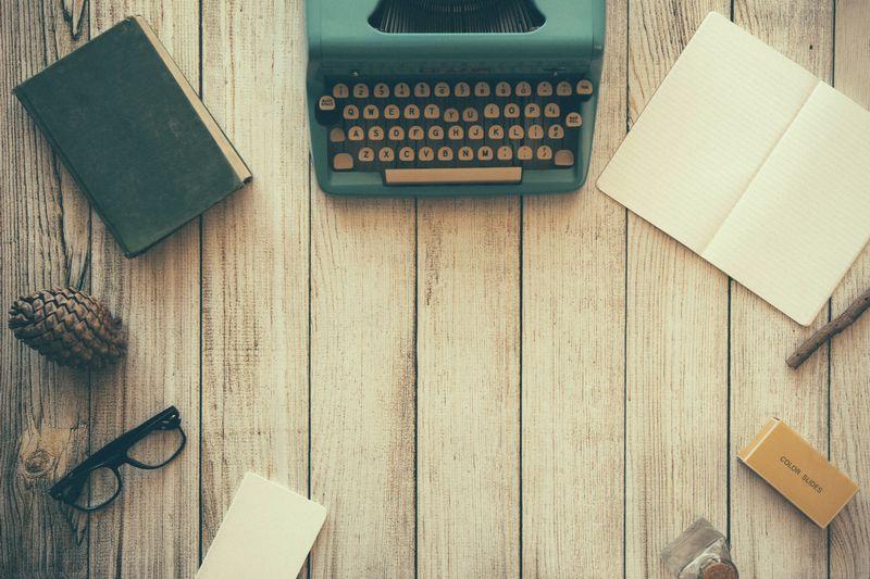 Photo of Typewriter on Wooden Desk