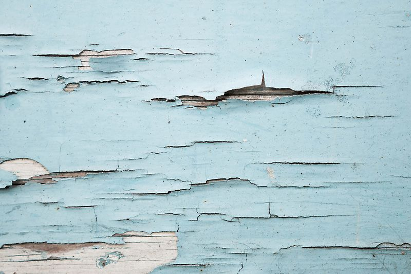 Photo of Chipped Light Blue Paint on Wood