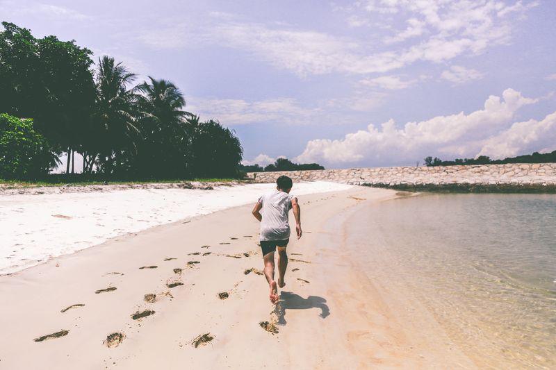 Photo of Man Running on Beach