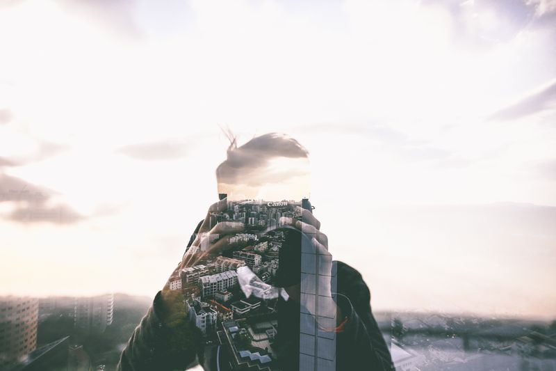 Photo of Man and Buildings Double Exposure