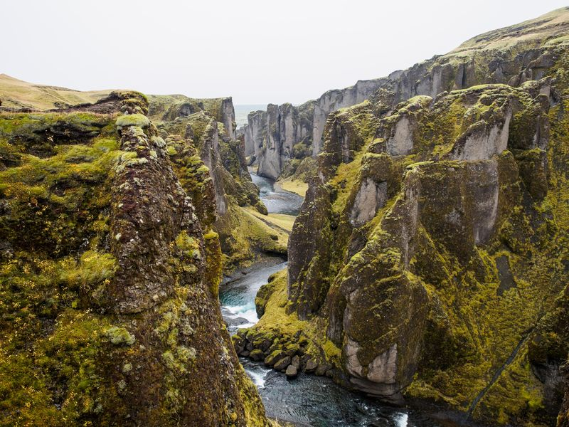 Photo of River and Mossy Cliffs
