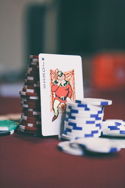 Photo of Poker Chips and Joker Playing Card