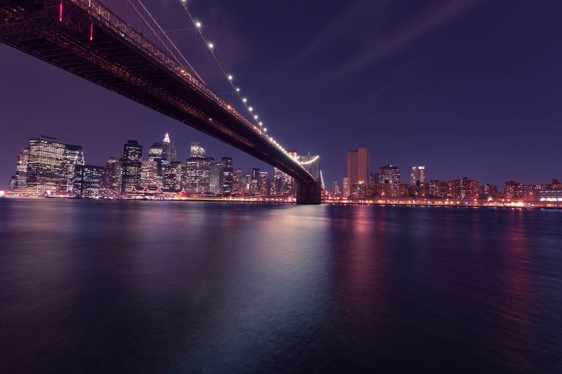 Photo of Brooklyn Bridge over the East River at Night