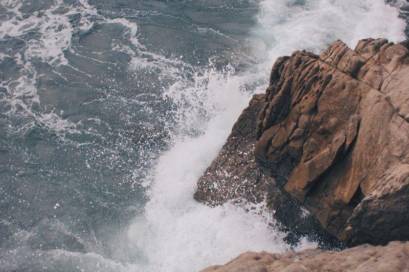 Photo of Waves Crashing Against Rocks