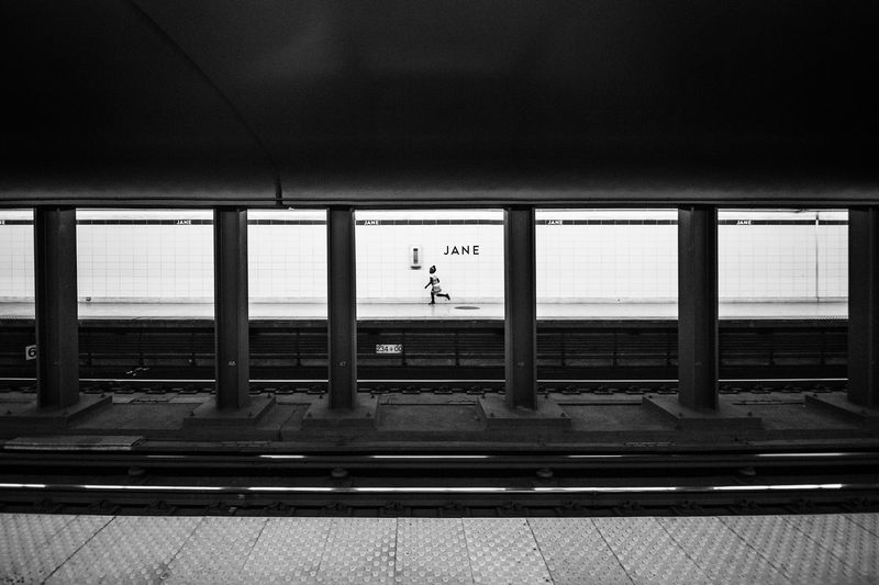 Photo of Girl Running in Subway Station
