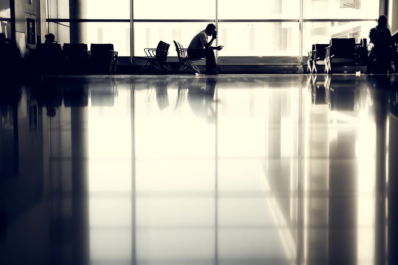 Photo of People in Airport Terminal