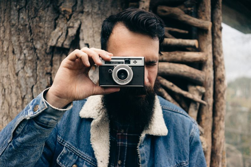 Photo of Man Taking Photograph