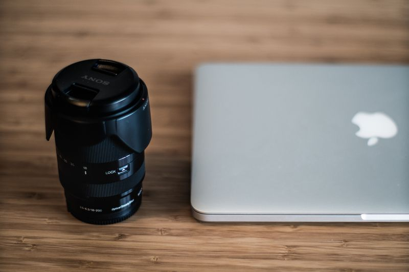Photo of Camera Lens and Laptop