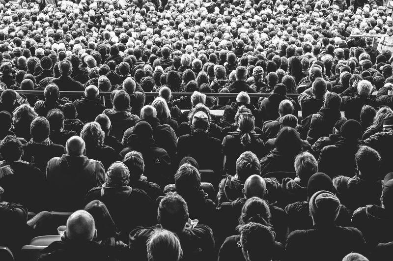 Photo of Crowd of People Looking Forward