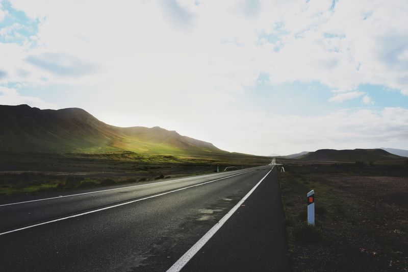 Photo of Open Road and Grassy Hills