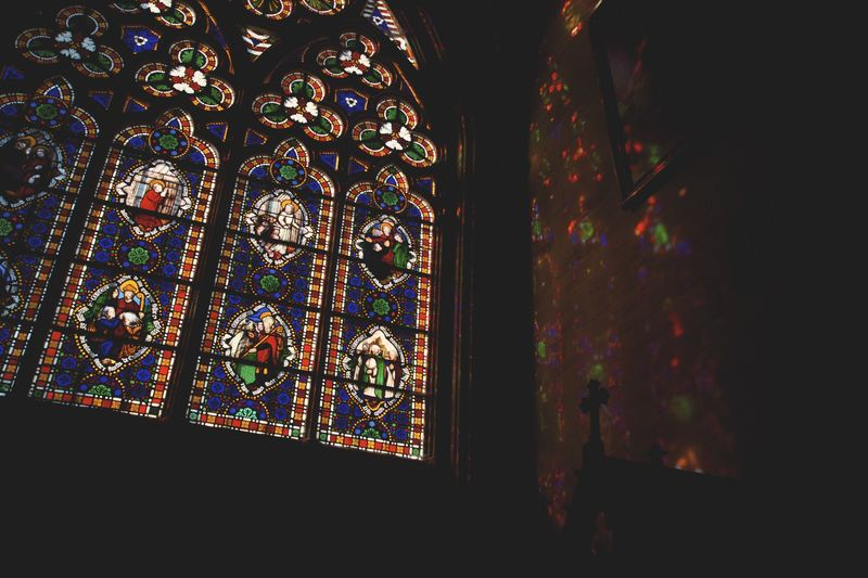 Photo of Icons in Stained Glass Windows