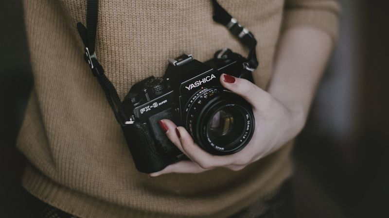 Photo of Girl Holding Camera