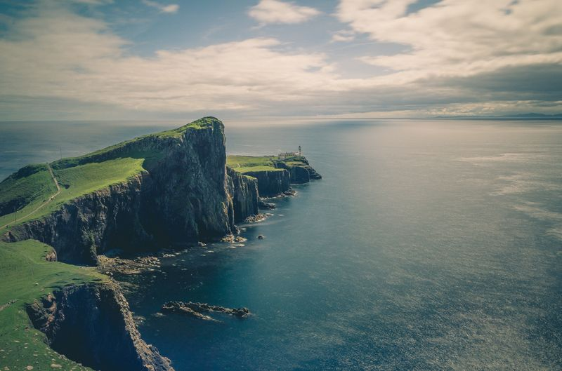 Photo of Grassy Hills and Coastal Cliff
