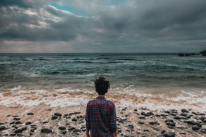 Photo of Man Watching Waves