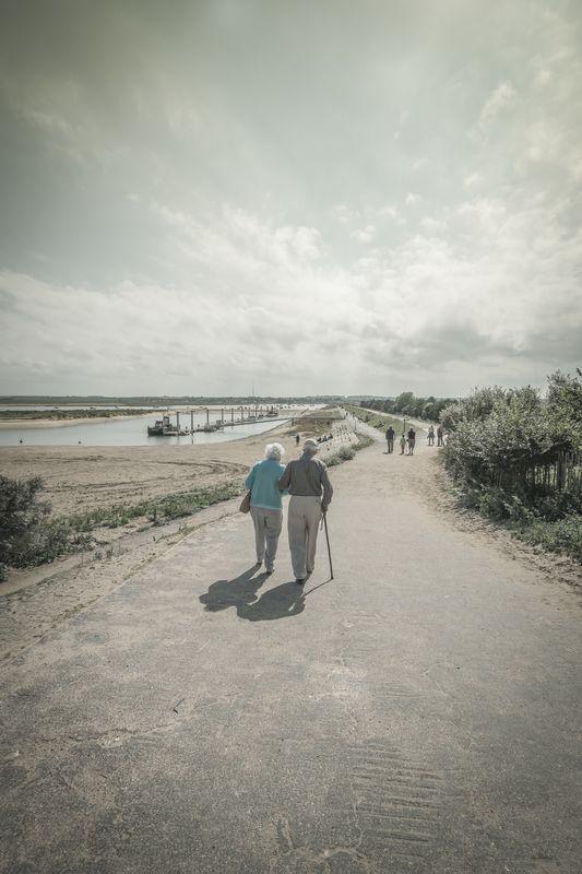 Photo of People Walking on Shore