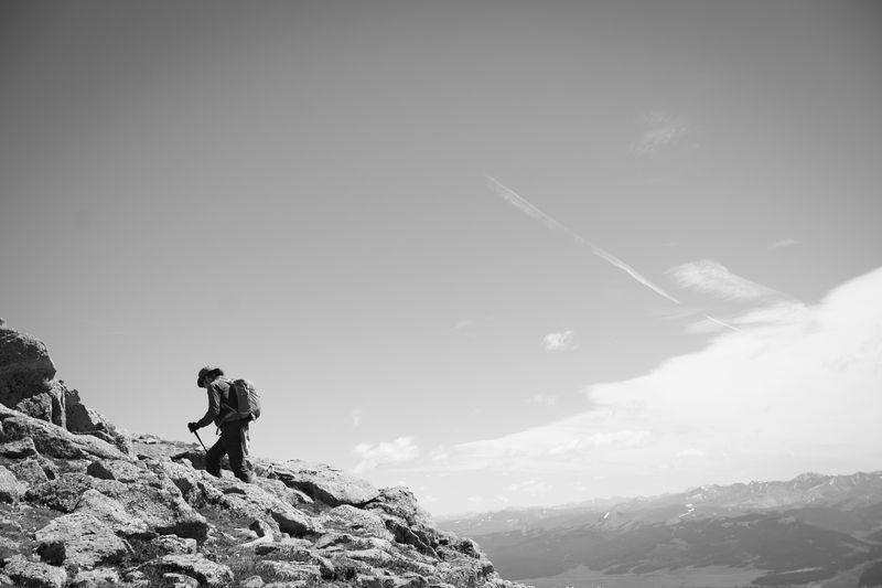 Photo of Man Hiking Up a Mountain