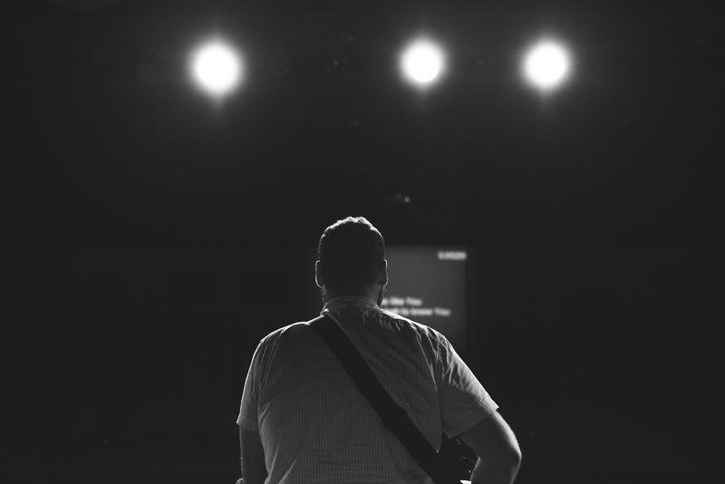 Photo of Man Playing Guitar and Singing