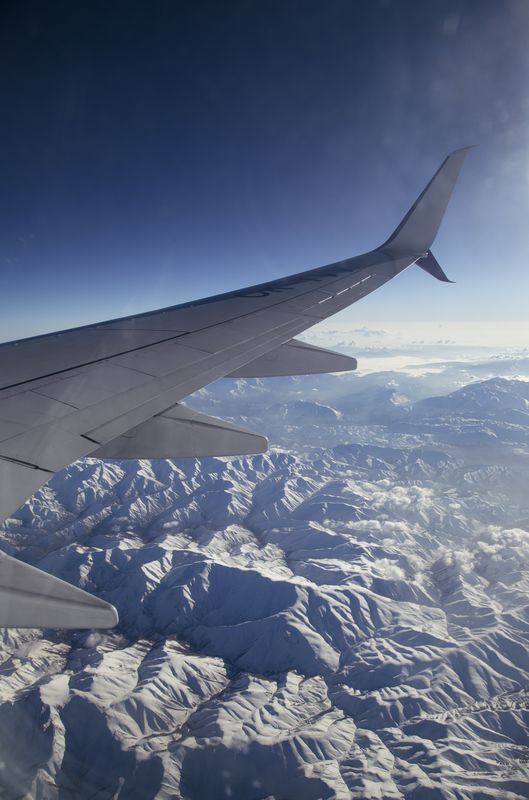 Photo of Airplane Flying over Mountains