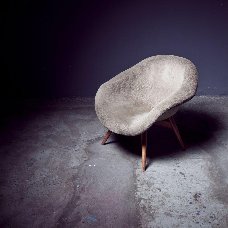 Photo of Plush Chair on Concrete Floor