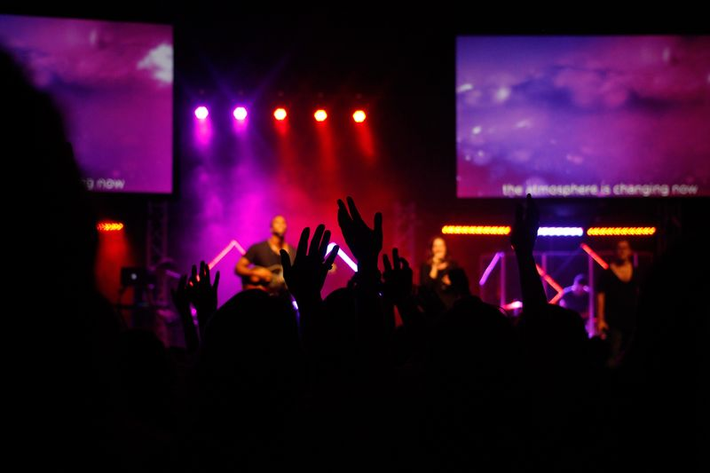 Photo of Hands Raised at a Worship Service