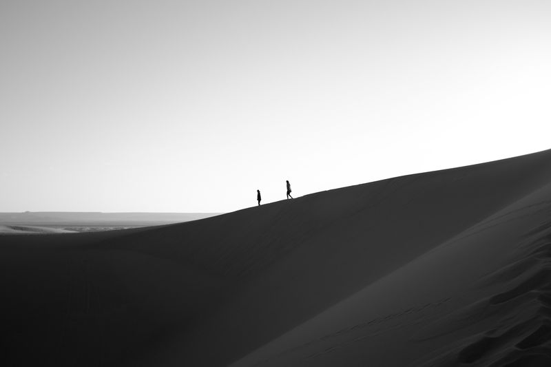 Photo of Two People in Desert