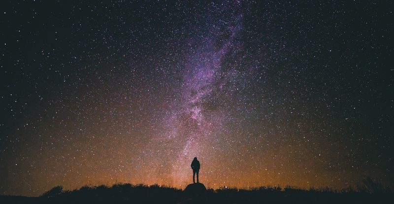 Photo of Person Staring at Nebula