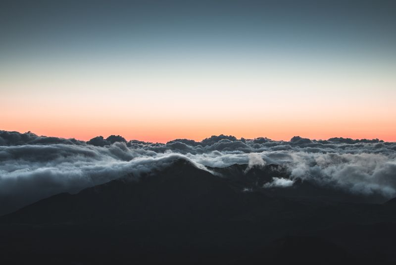 Photo of Clouds Touching Mountain Peaks