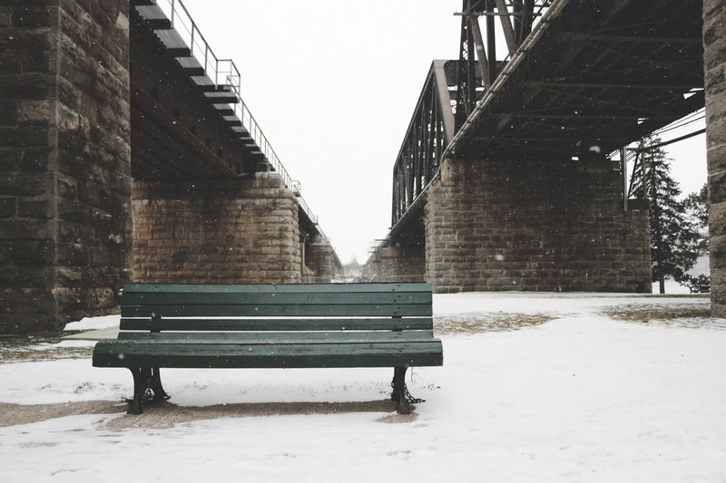 Photo of Bench in a Snowy Park