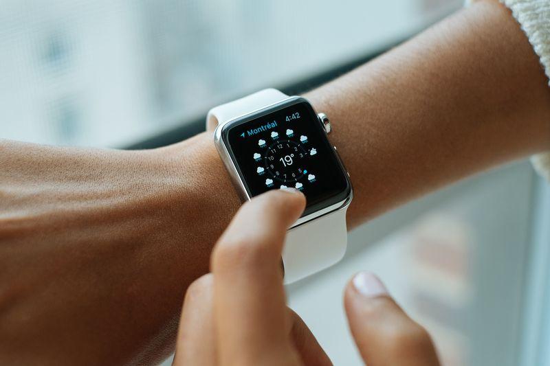 Photo of Woman Using Smart Watch
