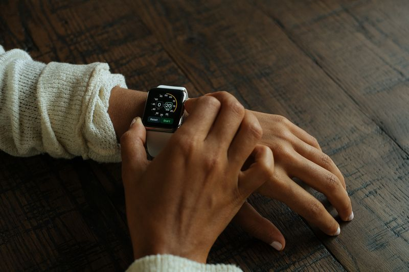 Photo of Woman Using Smart Watch