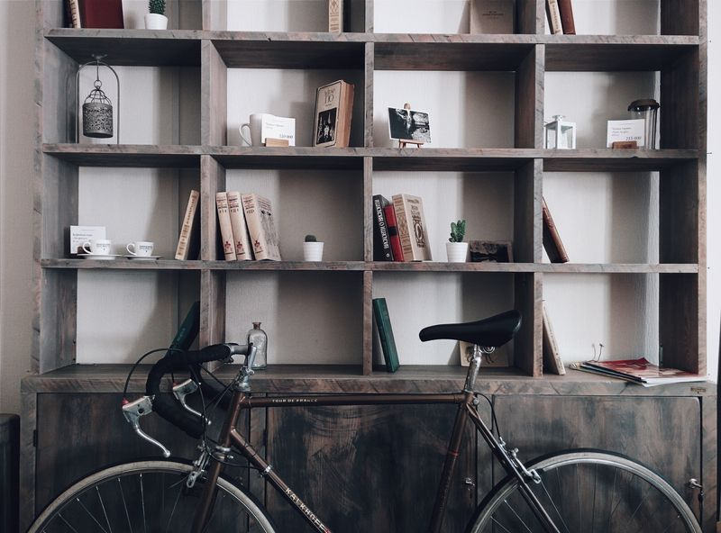 Photo of Bicycle and Bookshelves