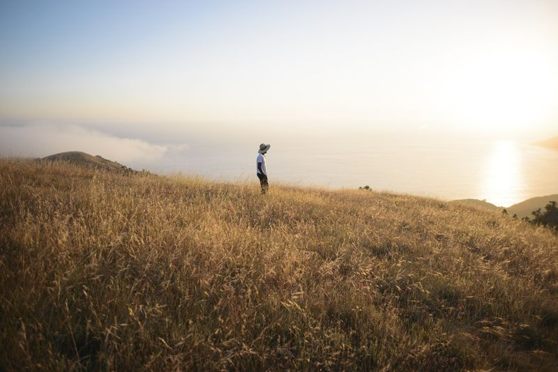 Photo of Man Standing in Field