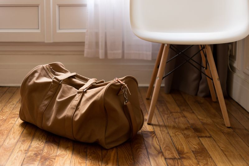 Photo of Duffel Bag and Chair