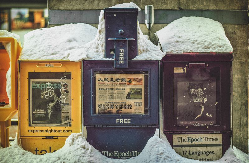 Photo of Newspaper Stands in Snow
