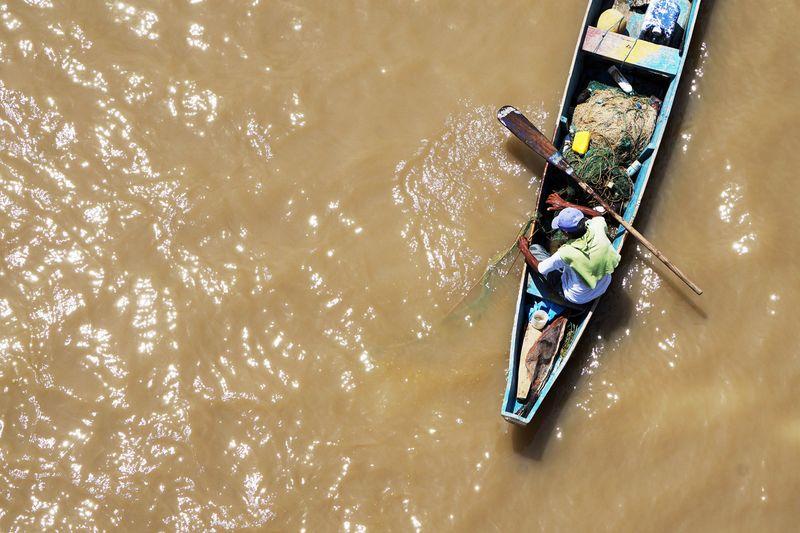 Photo of Man in Canoe in Water