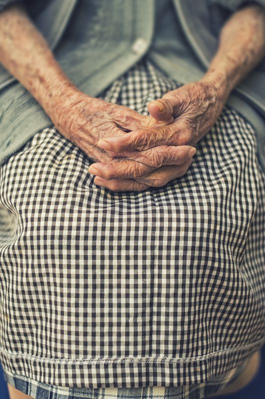 Photo of Old Woman's Hands Folded in Her Lap