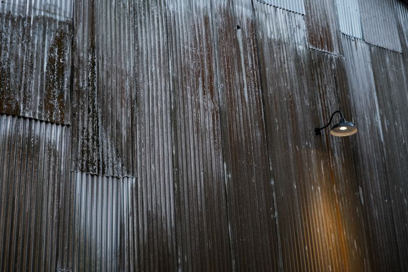 Photo of Metal Barn Wall with Lamp