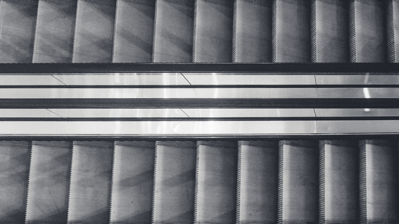 Photo of Two Escalators from Above