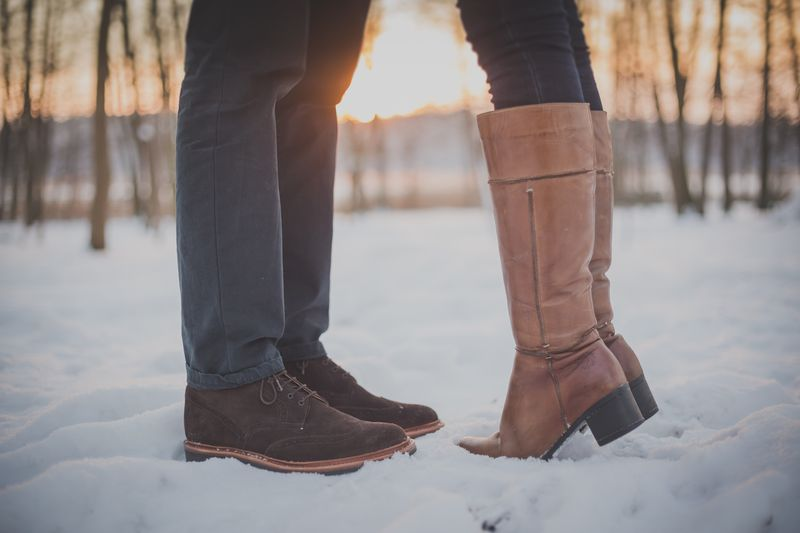 Photo of Couple Standing in Snow